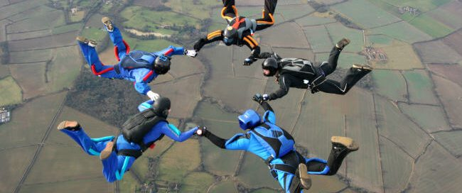 Skydivers holding hands representing online link building