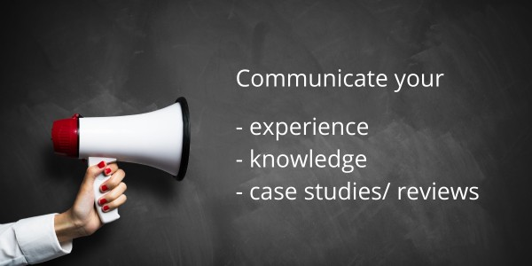 blackboard, loud speaker and words: communicate your experience